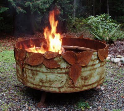 garden fire pit - unusual old rusty barrel with rusty embellishments