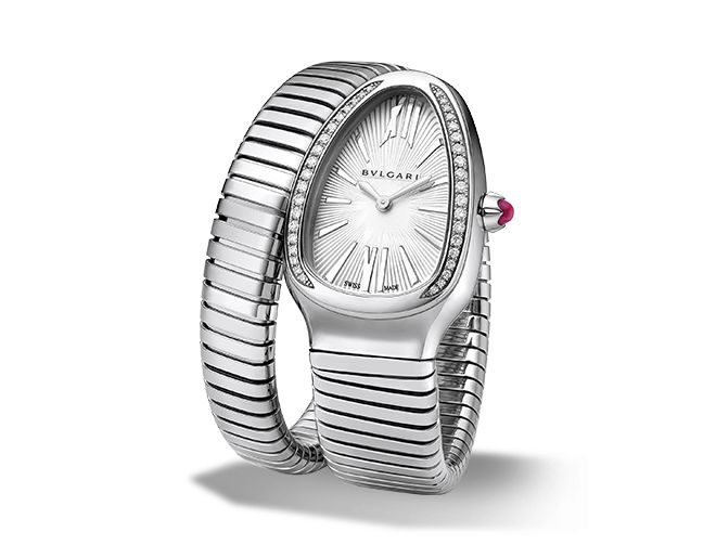 Quartz movement. 35 mm steel curved case set with brilliant-cut diamonds. Steel crown set with a cabochon-cut pink rubellite. Silver opaline dial with guilloch