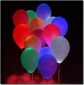 Lighted balloons! Love this simple idea for a night-time outdoor party… add a glow stick to the balloon! =)