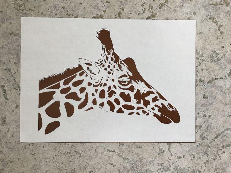 Giraffe paper cutting. I put glossy brown paper behind it.