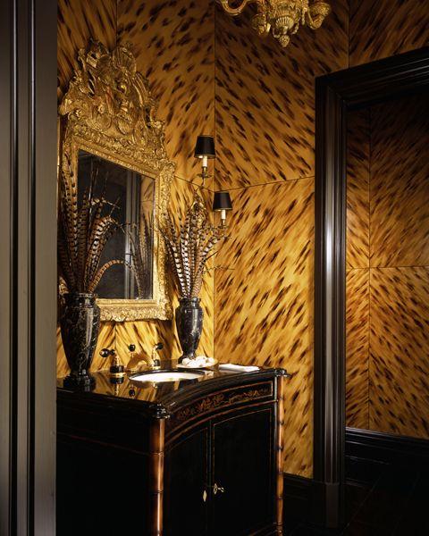 Dramatic powder room with faux tortoiseshell walls #powderroom #walltreatment #bathroom #interiordesign - More wonders at www.francescocatalano.it