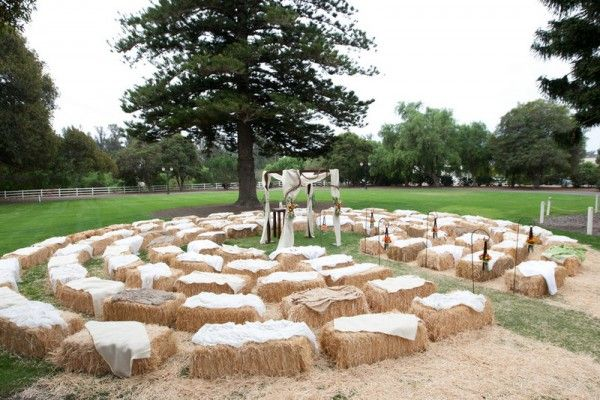 hay bale ceremony seating - you could dress them up a bit more using pretty quilts. love the circular arrangement too!