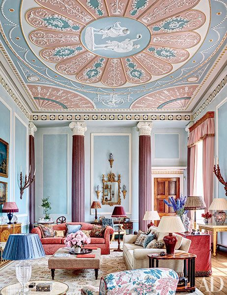 In a four-story apartment at England's Burley on the Hill, interior designer Mark Gillette created an elaborate painted ceiling in the drawing room in dusty pinks and pale blues.