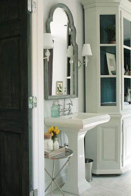 Framed mirror flanked with sconces the way to add an for Bathroom 3 way mirror