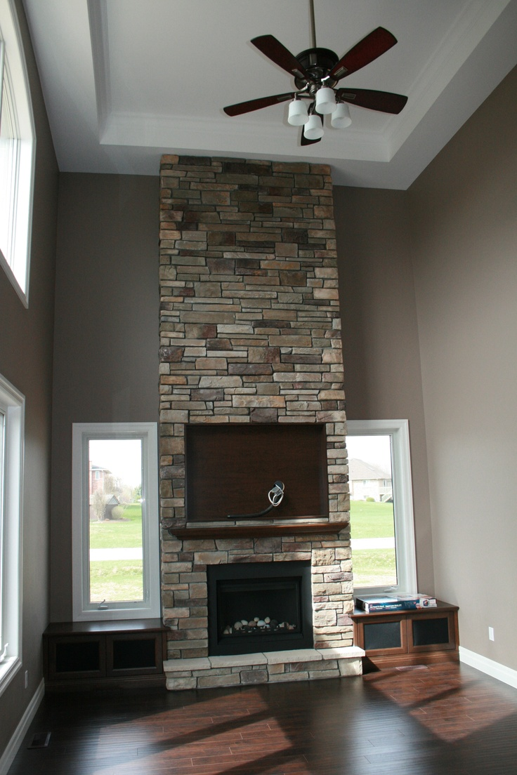 this soaring 18 foot high stone fireplace is the focal point of the main living area once again clean lines with rustic accents creates a great blend