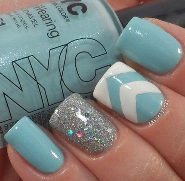 Light blue nails with chevron stripes and a silver accent.