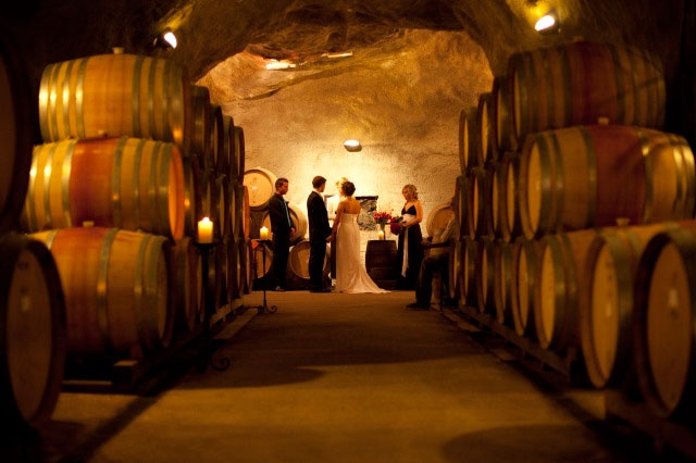 A couple gets married in New Zealand's largest wine cave.