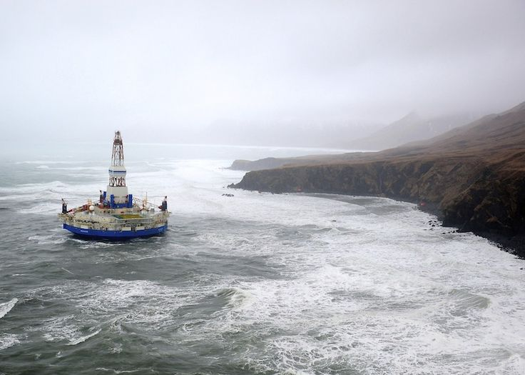 The conical drilling unit Kulluk sits aground on the southeast shore of Sitkalidak Island about 40 miles southwest of Kodiak City, Alaska, in 40 mph winds and 20-foot seas Tuesday, Jan. 1, 2013. The Kulluk grounded following many efforts by tug and Coast Guard crews to tow the vessel to a safe harbor when it was beset by winter storm weather during a tow from Dutch Harbor, Alaska, to Everett, Wash. U.S. Coast Guard photo by Petty Officer 1st Class Sara Francis. #offshore #oil #engineering