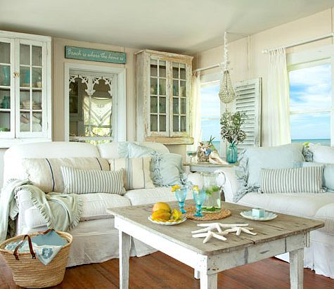 Shabby chic white & pastel living room in a beach cottage. Take the tour here: http://www.completely-coastal.com/2015/08/small-shabby-chic-beach-cottage-FL.html