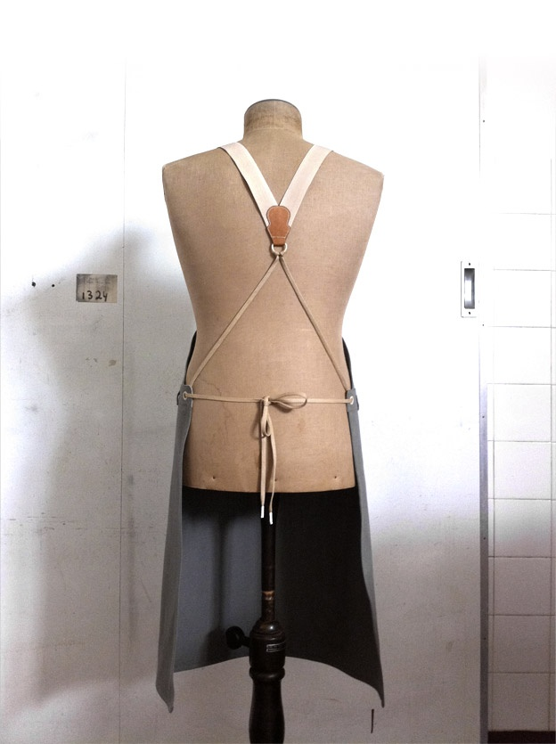 a masculine apron, but could probably be more feminine with pretty suspenders