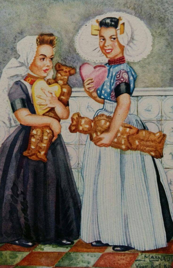Zeeuws meisjes met allebei een speculaaspop (vrijer) en een liefdeshart.