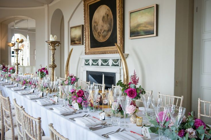 Table decor at Aynhoe Park with pink flowers