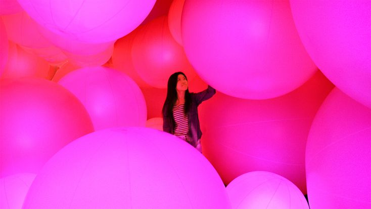 luminous colored spheres by team lab respond to human touch
