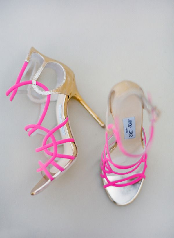 Strappy pink Jimmy Choo heels: http://www.stylemepretty.com/2015/06/16/wedding-day-shoes-worth-showing-off/