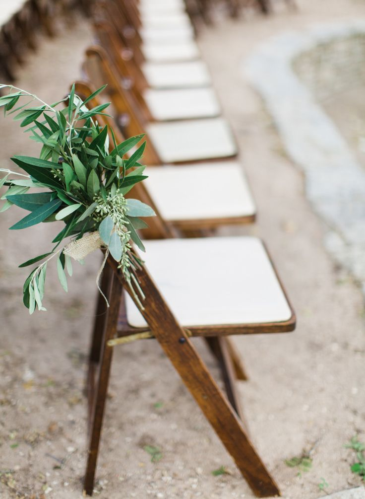 Ceremony chair decoration. Add white ranunculus. #chair-decor Photography: Loft Photographie LLC - www.loftphotographie.com Read More: http://www.stylemepretty.com/2014/04/18/elegant-garden-wedding-in-austin/