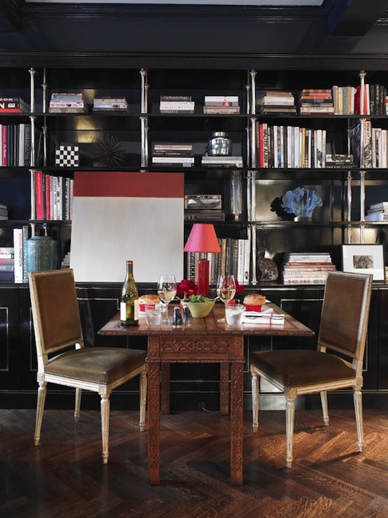 dinein library miles redd designed the ebonized wood and sterling bookshelf where a colorblock painting by leora armstrong hangs when theyu0027re alone