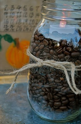 tea lights in coffee beans... light it and your whole house will smell like coffee. :)