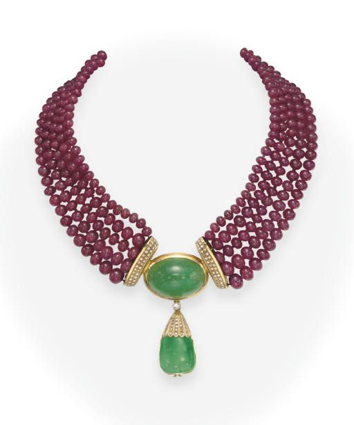 A RUBY BEAD AND EMERALD NECKLACE Designed as five rows of graduated ruby beads, measuring from approximately 5.30 and 8.60 mm, with circular-cut diamond terminals, joined by a bezel-set oval cabochon emerald pendant, suspending a tapered square cabochon emerald with a diamond cap, mounted in gold, 15 ins.
