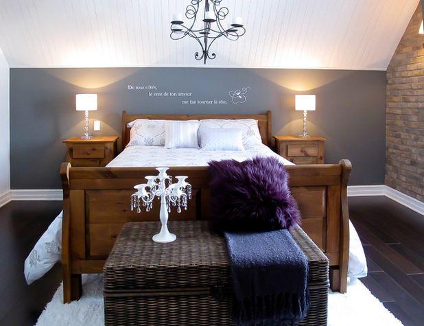Contemporary Bedroom by Eurêka! Design with dark grey-blue feature wall