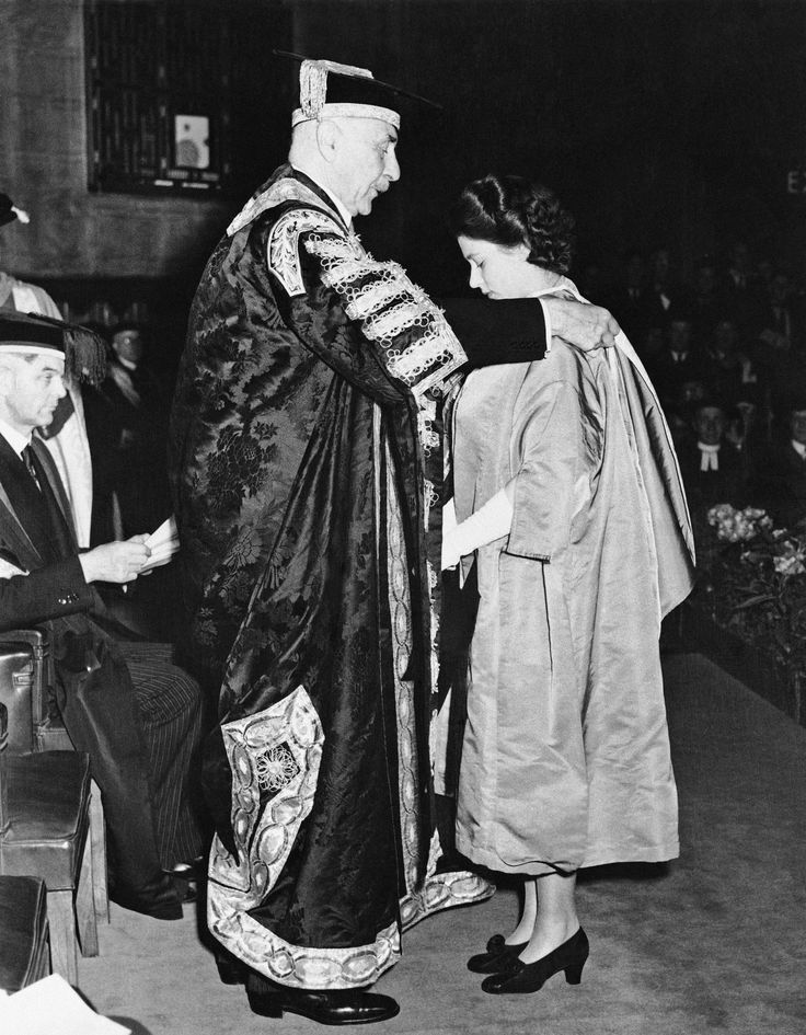 Princess Elizabeth receives the hood of a Bachelor of Music from the Earl of Athlone, Chancellor of London University, and her great uncle, during exercises at the University's Senate House on July 10, 1946 in London.