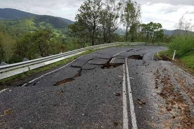 Distressing images from Queensland's Sarina show a road cracked in two after heavy downpour triggered flash floods. Photo/Rebecca Takken supplied via Facebook