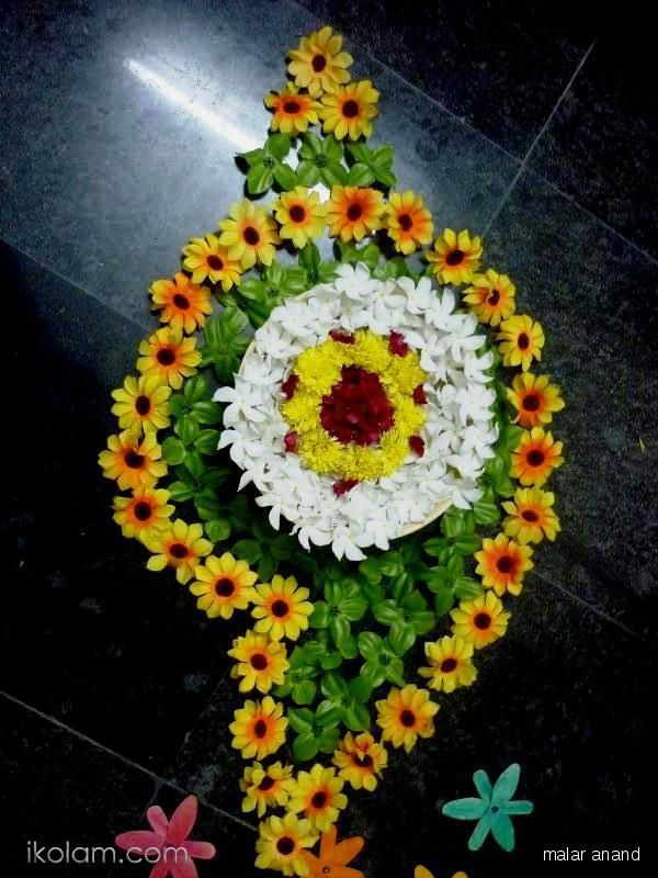 """Hi friends, this is the conch design done by me with flowers..."" by malar anand on www.iKolam.com"