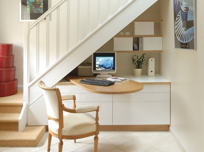 Interesting idea to have a desk that swings out from on top of cabinetry under  stairs