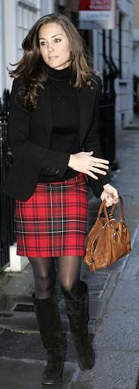 tartan+black. trés casual. might look softer if another tartan with deep navy and navy sweater and tights? too much? she is young enough to do it well. Just nice to see casual l dress in a hurry look, before bag is changed. When was this taken?