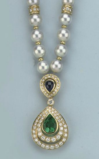 A CULTURED PEARL, GEM SET AND DIAMOND NECKLACE Strung with uniform cultured pearls divided by diamond set spacers, supporting a pendant set with a pear-shaped emerald and cabochon sapphire surrounded by brilliant-cut diamonds, 42.0 cm long