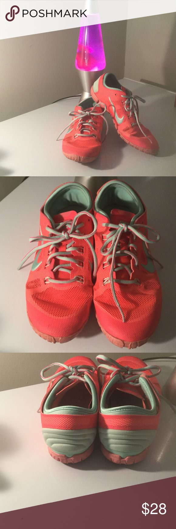 Nike training sneakers, size 7 Nike training shoes, size 7. Extremely lightweight, fabric upper. Color is coral with grey trim, pleasant combination. EUC, worn very little. Nike Shoes Sneakers