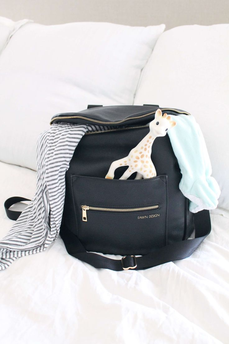 Fawn Design Diaper Bag. The best diaper bag backpack. What you really need in your baby bag. What you need to pack in your diaper bag the first year. When you're a mom of two or more, these are the things you can't leave home without! #bestbabybag #diaperbagessentials #diaperbag #diaperbagmusthaves