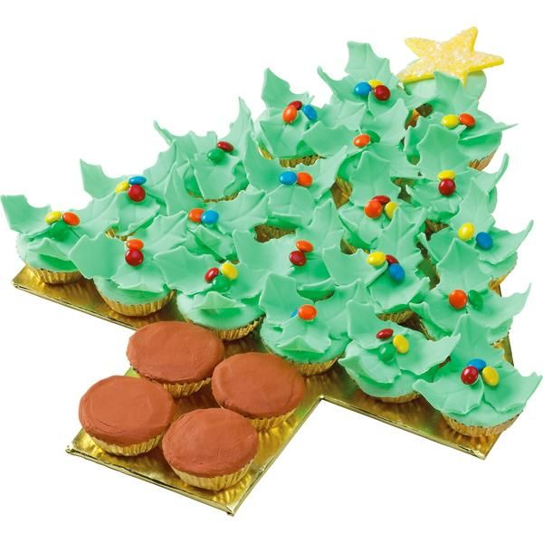 Holiday Holly Tree Cupcakes - Curved fondant holly leaves add dimension to this tree-shaped  arrangement of mini cupcakes. Candy-coated chocolates are  used for the colorful berries.