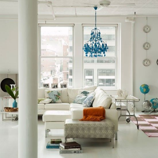 modern white room with pop of ornate turquoise blue via the chandelier, living etc. magazine;