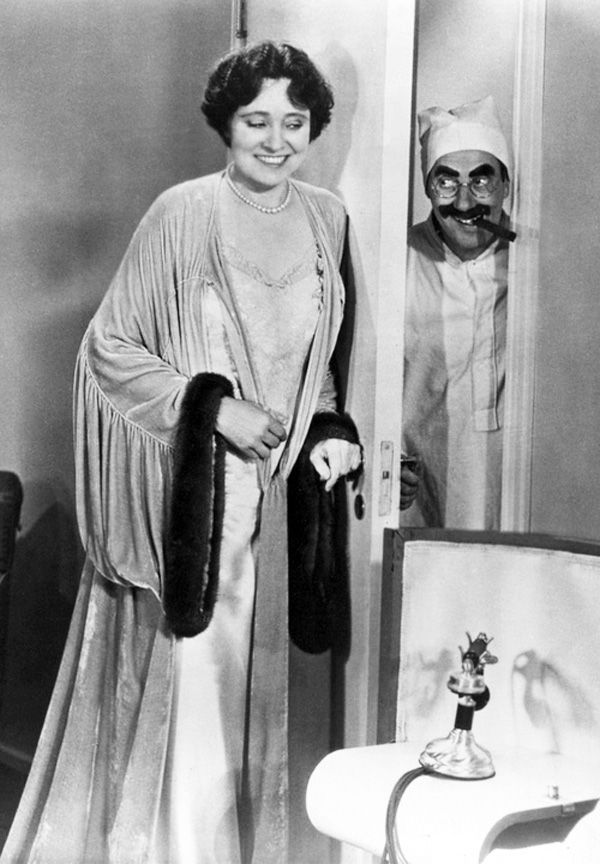 groucho: Not that I care, but where is your husband? Mrs. Teasdale: Why, he's dead. groucho: I bet he's just using that as an excuse. Mrs. Teasdale: I was with him to the very end. groucho: No wonder he passed away. Mrs. Teasdale: I held him in my arms and kissed him. groucho: Oh, I see, then it was murder. Will you marry me? Did he leave you any money? Answer the second question first.