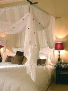 Suspended Four Poster Mosquito Net - must put ours up again in the new house. Looks so pretty.