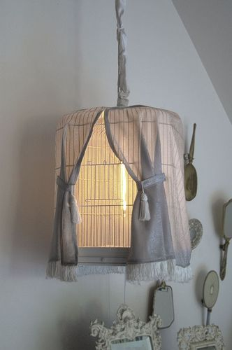 @Heather Grundon. Birdcage with its own curtain. Repurposed your old birdcages into a birdcage lamp with a hanging lamp kit, a curtain and chain cozy. CUTE <3