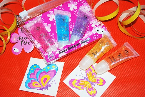 You choose a cellophane bag and optional sweets. We will fill it with a pouch of five Miners Glitzy Kitz mini body glitters (safe for children from 3 years) and two temporary glitter butterfly tattoos. £2.20