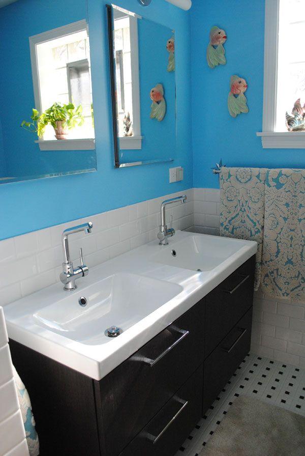 IKEA Godmorgon vanity and sink, Kohler recessed medicine cabinets, Rejuvenation towel rod, Anthropologie towels, vintage chalkware... Different paint color.