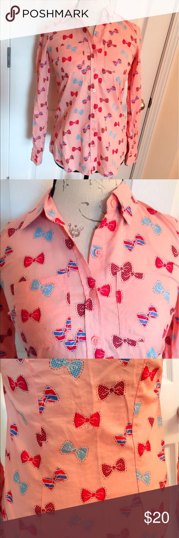 Red Camel Juniors Long Sleeved Shirt w/ Bow Print Brighten up your day with this Red Camel Pink button down shirt with printed bows. Long Sleeved. 100% Cotton. Great with dark colored jeans. Never used, brand new with tag. Red Camel Tops Button Down Shirts