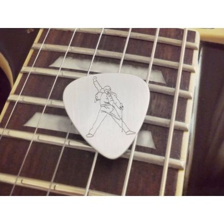 This awesome silver pick is inspired by Freddie Mercury (1946–1991) and his impressive vocals and performances  Made of rhodium plated sterling silver 925  Dimensions: 30mm height, 0.6mm thickness  Our designs of the silver picks are based on famous pictures related to music history  Manufacturing process includes treatment by hand and laser