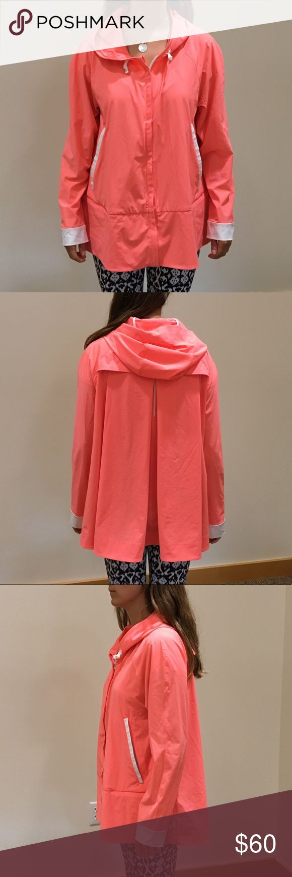 Lulu Lemon Women's Pink Zip Up Hoodie Jacket 10 This fun jacket is lightweight and comfortable. It's stretchy and almost feels like a light rain jacket material. It fits sort of like a poncho in the back and has a zip closure and hood. There is mesh in the upper back (pictured) and hand pockets. It is in awesome condition aside from two tiny black marks on the back (pictured) that aren't really noticeable when wearing. Perfect for covering up before and after a workout, or even during…