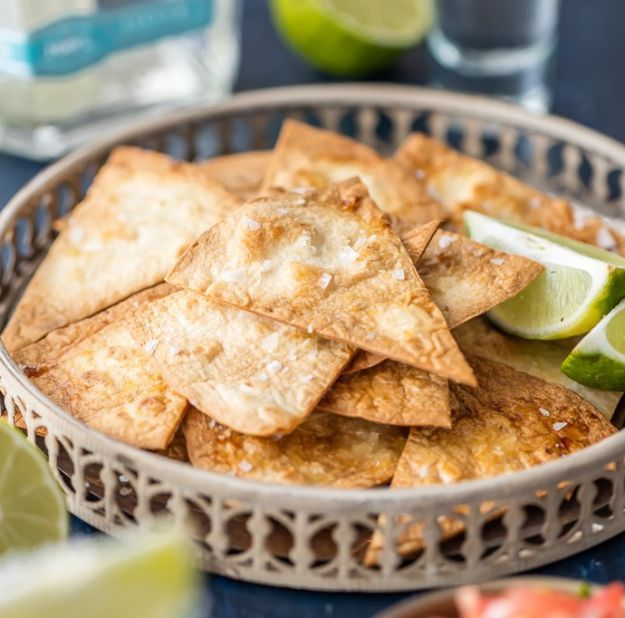 Tequila Lime Baked Tortilla Chips | 12 Healthy Chips Recipes To Try At Home | Make your weekend more enjoyable and fun with these Crunchy and Tasty Chips Recipe - sooo Easy and Simple to make! http://homemaderecipes.com/healthy-chips-recipes/