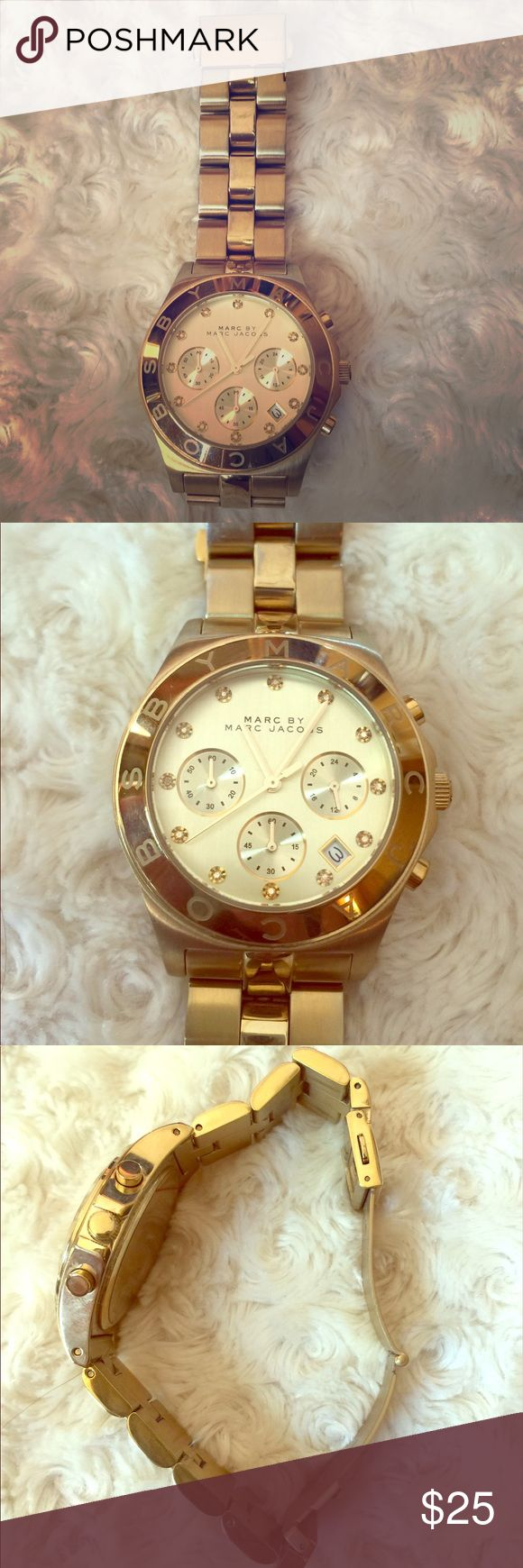 Marc by Marc Jacobs gold oversized watch 100% authentic Marc by Marc Jacobs watch. Preloved condition. Minor scratches and discoloration due to normal use. Need a new battery. I haven't used this watch for years and kept it in my closet. Marc By Marc Jacobs Accessories Watches