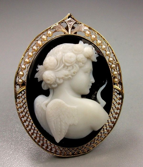 Museum Quality hard stone cameo depicting Cupid, the God of Love. This cameo is three-dimensionally carved.
