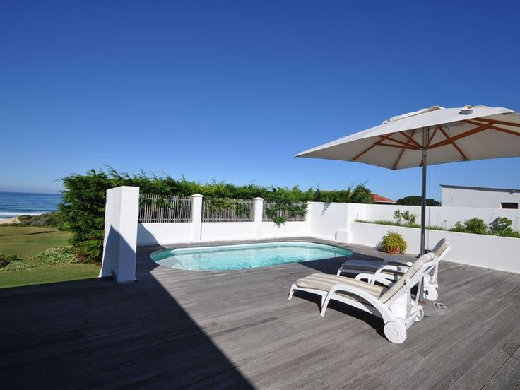Ocean Mist - Ocean Mist Beach Villa is a beautiful and charming beach house located within a private beach-front housing estate in Keurboomstrand, near Plettenberg Bay. With rolling lawns leading directly onto the ... #weekendgetaways #keurboomstrand #southafrica