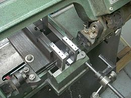 Double V-Jaw - Homemade double v-jaw attachment for a horizontal bandsaw intended to facilitate the process of cutting cylinders down the middle while laying flat or on end.