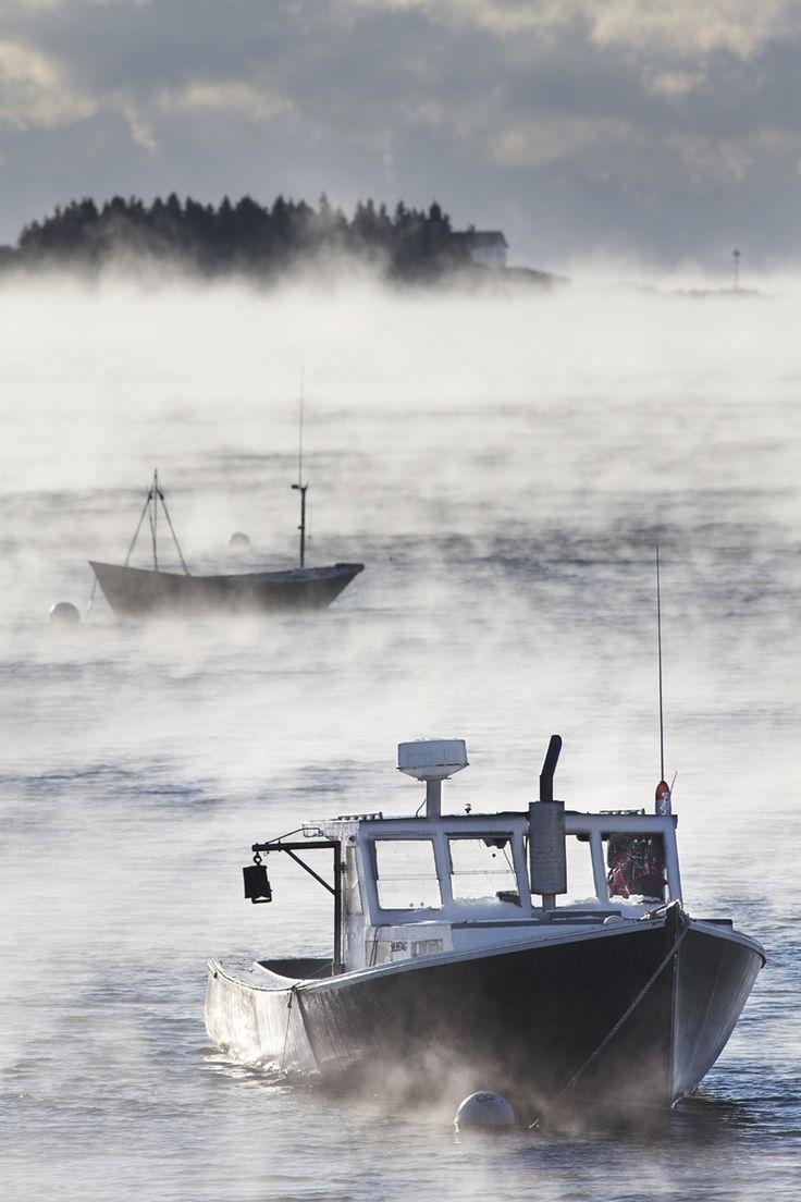 Lobster boats shrouded in sea smoke.