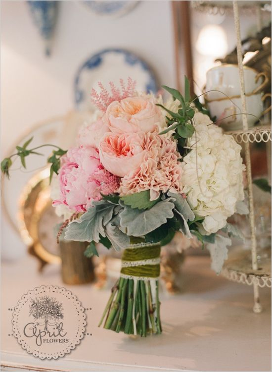 pink, peach, and white bridal bouquet with astilbe, peonies, hydrangea, and garden roses.  i love the olive velvet ribbon wrapped around the handle.