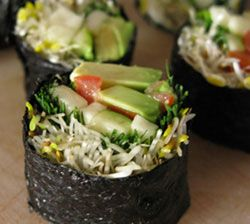 Raw vegan sushi roll:  1 raw, untoasted nori sheet  1/2 avocado  1-2 sprigs of fresh dill  1/4-1/2 raw zucchini  1 handful of sprouts (alfalfa, sunflower, etc…)  1 small tomato  1 tablespoon of dulse flakes