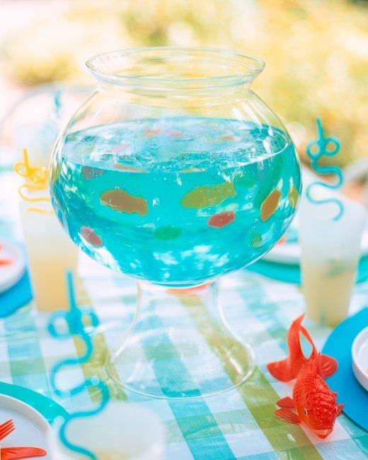 Fish Bowl Gelatin ~ this bowl filled with gelatin, soda, and gummy fish is a fun display for a kids' room. TIP: To make the soda go flat, twist off cap, and let the bottle stand at room temperature overnight. This project fills a 2 1/2-quart fish or glass bowl ~ fun, Fun, FUN!